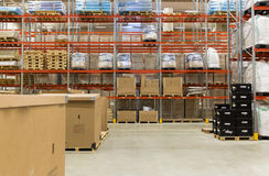 Cargo boxes storing at warehouse shelves Stock Image