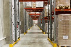 Cargo boxes storing at warehouse shelves Stock Photos