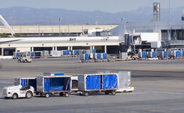 Cargo carts in airport. Filed of an airport with baggage transportation cars Royalty Free Stock Image