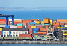 Cargo container. Port cargo container over blue sea background Royalty Free Stock Photo