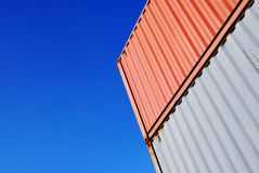 Cargo container. Stapled cargo container and a blue sky Royalty Free Stock Photo