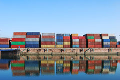 Cargo container. In a harbour with water reflections Stock Image