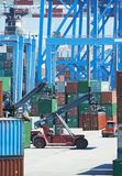 Cargo container boxes in dock terminal Stock Photography
