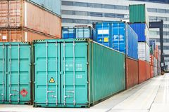 Cargo container boxes in dock terminal. Stack of container box after sorting in warehouse dock terminal of cargo sea port Stock Photo