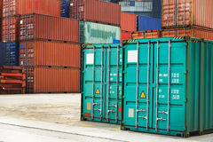 Cargo container boxes in dock terminal. Stack of freight container boxes after sorting in warehouse dock terminal of cargo sea port Stock Photo