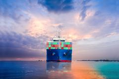 Cargo container chip. Logistics and Transportation of international Container Cargo ship and Cargo plane in the sea on sunset blue sky background Stock Photos