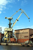 Cargo Container Cran. Yellow cargo container crane at harbor royalty free stock photography
