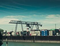 Cargo container crane in shipping port Royalty Free Stock Photo