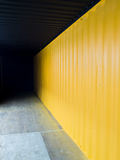 Cargo container deep to the dark with yellow wall. Cargo container deep inside to the dark with yellow wall Royalty Free Stock Photos