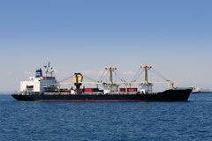 Cargo container freighter ship sailing Royalty Free Stock Image