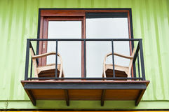 Cargo container home balcony. Green cargo container home balcony Stock Photo