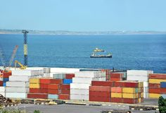 Cargo container. Port cargo container over blue sea background Royalty Free Stock Photos