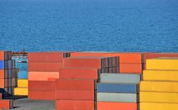 Cargo container. Port cargo container over blue sea background Royalty Free Stock Image