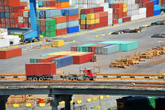 Cargo container in port and truck Stock Photography