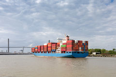 Cargo Container Ship Approaching Port of Savannah, GA. Fully loaded cargo container ship approaching the Talmadge Memorial Bridge as it enters Port of Savannah Stock Image