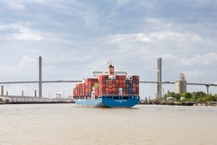 Cargo Container Ship Approaching Port of Savannah, GA. Savannah, GA - March 27, 2017:  Container ship approaching the Talmadge Memorial Bridge on the Savannah Stock Photography