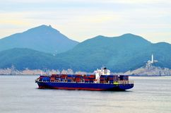 Cargo container ship arriving to port of Busan, South Korea. stock image
