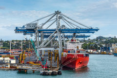 Cargo Container ship docking Stock Images