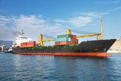 Cargo container ship in ocean Stock Photo