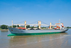 Cargo container ship on river Stock Images