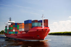 Cargo container ship on river. Cargo container ship - freighter navigating river Royalty Free Stock Photos