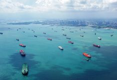 Cargo container ships lined up to enter the port of Singapore. CHANGI, SINGAPORE -Aerial view of the lines of cargo container ships waiting to enter the port of Royalty Free Stock Photography
