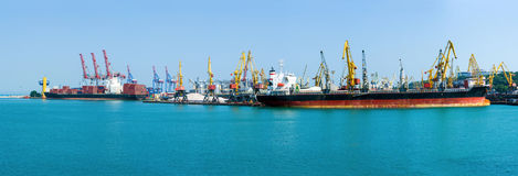 Free Cargo Container Terminal Of Sea Freight Industrial Port. Large Grain Elevator. Bulk Carrier And Container Ship Are Moored For Load Royalty Free Stock Image - 97083326