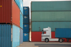 Cargo Container and truck. Stacks of Cargo container and a truck Stock Photography