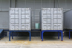Cargo Container. Two Silver Shipping Containers in Front of Warehouse Stock Photos