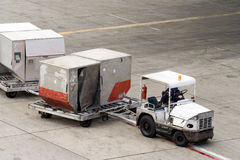 Cargo containers. Delivering containers to the plane Royalty Free Stock Image