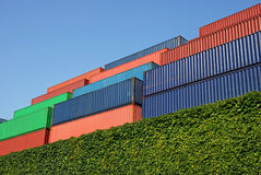 Cargo containers. Stack of Multicolored freight containers Stock Photo
