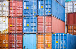 Cargo containers closeup. Stacked cargo containers in storage area of freight port terminal Stock Photo