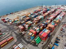 Cargo containers in the sea port ready for transportation by ship.  stock images