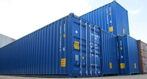 Cargo containers. Several blue cargo containers used for the transport or transfer of materials by air or sea royalty free stock images