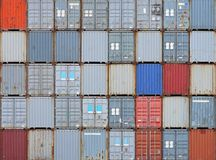 Cargo containers. Stacked shipping containers at cargo terminal Royalty Free Stock Photos