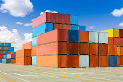 Cargo containers. Stacks of colorful cargo containers stock images