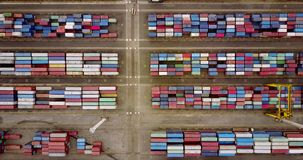 Cargo containers in Tanjung Priok port. JAKARTA, Indonesia. July 10, 2017: Top view footage of cargo containers with crane and truck in Tanjung Priok port. Shot