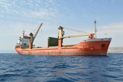 Cargo containership. Red cargo freight container ship in the Red Sea Royalty Free Stock Photography