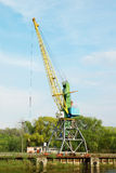 Cargo crane in abandoned river harbor Stock Photos