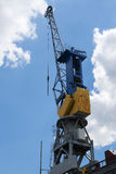 Cargo crane against the blue sky with clouds in the port of Hamb Stock Images