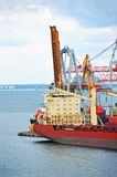 Cargo crane and container ship Royalty Free Stock Photos