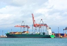 Cargo crane and container ship Stock Images