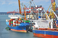 Cargo crane and container ship Stock Photography