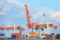 Cargo crane and container ship Stock Image