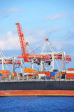 Cargo crane and container ship Royalty Free Stock Image