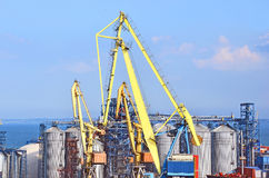 Cargo crane and grain dryer Royalty Free Stock Photography