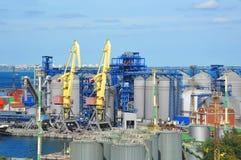 Cargo crane and grain dryer Stock Photo