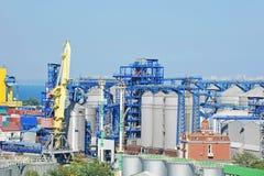 Cargo crane and grain dryer Royalty Free Stock Image