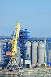 Cargo crane and grain dryer Stock Photos