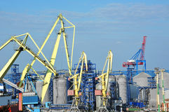 Cargo crane and grain dryer Royalty Free Stock Photo